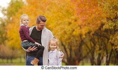 Portrait of happy family in autumn park