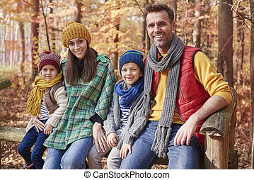 Portrait of happy family in the forest