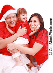 Portrait of happy family looking at camera and prepared for Christmas