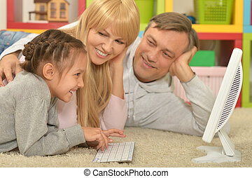 happy family playing  on computer