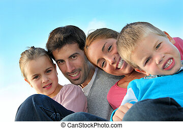 Portrait of happy family sitting outdoors