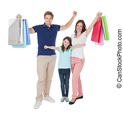 Portrait Of Happy Family With Shopping Bags