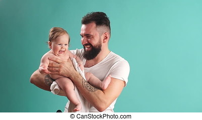 Portrait of happy father and his adorable little daughter....
