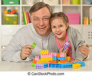 happy father  playing with little daughter