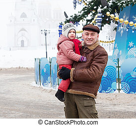 father with child in Christmas time