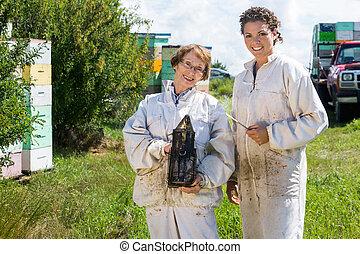 Portrait Of Happy Female Beekeepers