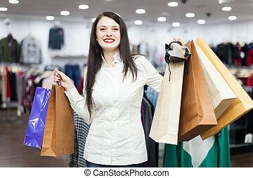 Portrait of happy female buyer