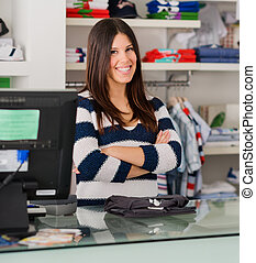 Happy Female Cashier At Cash Counter