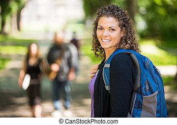 Portrait Of Happy Female Grad Student - Side view portrait...