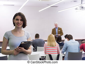 portrait of happy female student in classroom