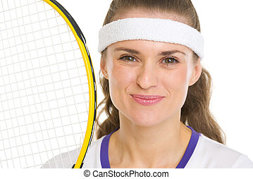 Portrait of happy female tennis player