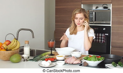 Portrait of happy female wife in white t-shirt cooking...