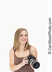 Portrait of happy female with photographic camera