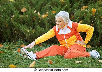 Portrait of happy fit senior woman exercising