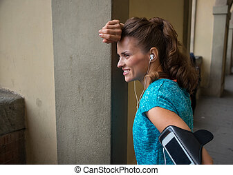 Portrait of happy fitness woman outdoors in the city