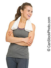 Portrait of happy fitness young woman looking on copy space