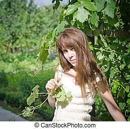 Portrait of happy girl in a vineyard