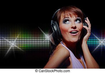 Portrait of happy girl listening a music in headphone.