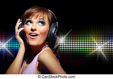 Portrait of happy girl listening a music in headphone