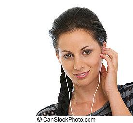 Portrait of happy girl listening music in headphones