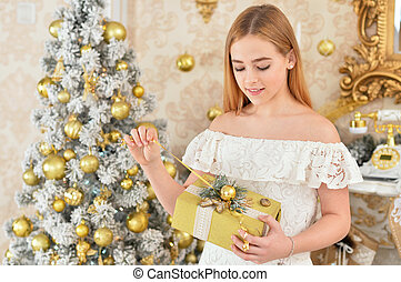 Portrait of happy girl with presents on Christmas