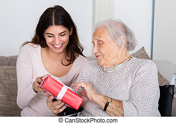Grandmother Giving Gift To Her Granddaughter