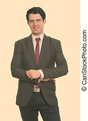 Portrait of happy handsome businessman in suit smiling