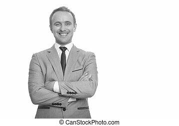 Portrait of happy handsome businessman in suit