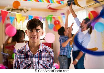 Portrait Of Happy Hispanic Child Smiling At Birthday Party