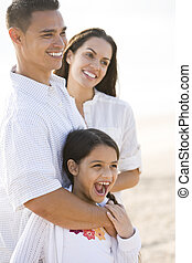 Portrait of happy Hispanic family with young girl