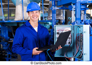 industrial engineer with laptop computer - portrait of happy...