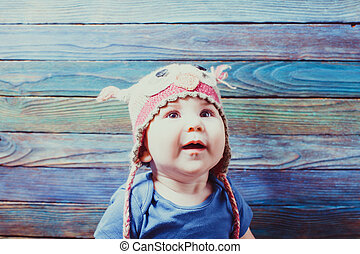 Portrait of happy infant baby in owl hat