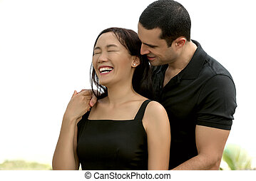 Portrait of happy interracial couple in love outdoor