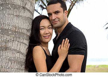 Portrait of happy interracial couple in love outdoor