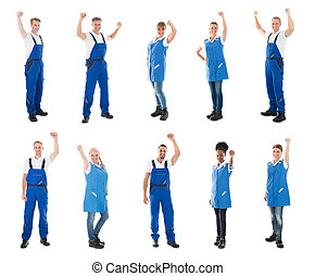 Portrait Of Happy Janitors Standing With Arms Raised