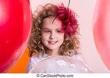 Portrait of happy joyful beautiful girl on a background of the l
