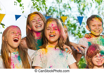 Portrait of happy kids smeared with colored powder