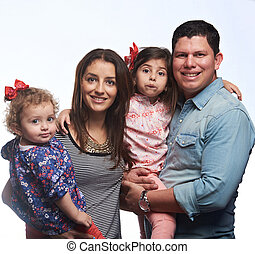 Portrait of happy latino family