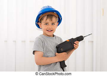 Boy Holding Electric Drill