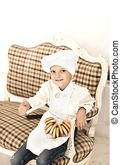 portrait of happy little boy in the shape of a chef