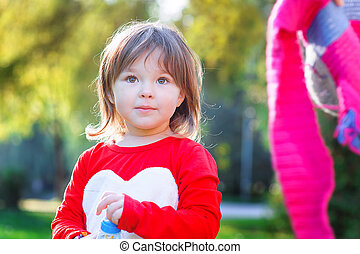 Portrait of happy little girl in the park