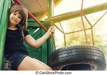 Portrait of happy, little girl on playground