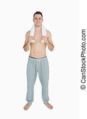 Portrait of happy man holding towel around neck