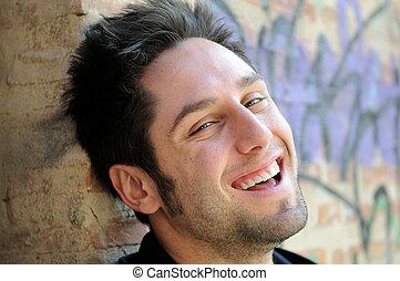 Portrait of happy man in urban background