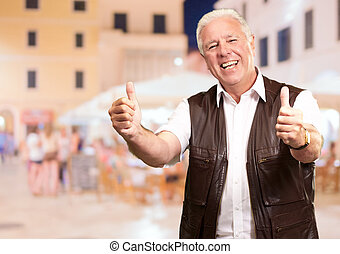 Portrait Of Happy Man Showing Thumb-up Sign