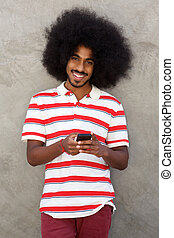 happy man with cellphone standing with afro