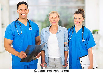 medical doctors with middle aged patient
