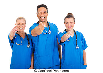 medical professionals pointing at the camera