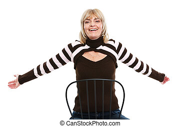 Portrait of happy middle age woman sitting on chair