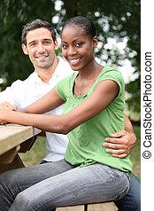 portrait of happy mixed couple